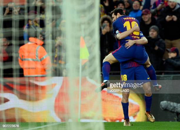 Barcelona's Argentinian forward Lionel Messi celebrates a goal with Barcelona's Uruguayan forward Luis Suarez during the Spanish league football...