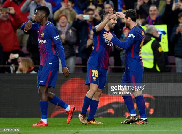 Barcelona's Argentinian forward Lionel Messi celebrates a goal with Barcelona's Spanish defender Jordi Alba during the Spanish league football match...