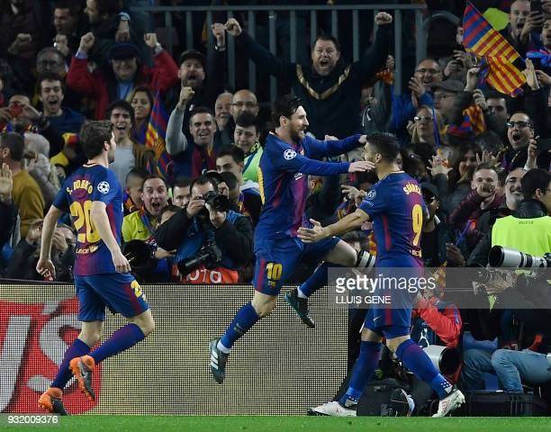 Barcelona's Argentinian forward Lionel Messi celebrates a goal with Barcelona's Uruguayan forward Luis Suarez during the UEFA Champions League round...