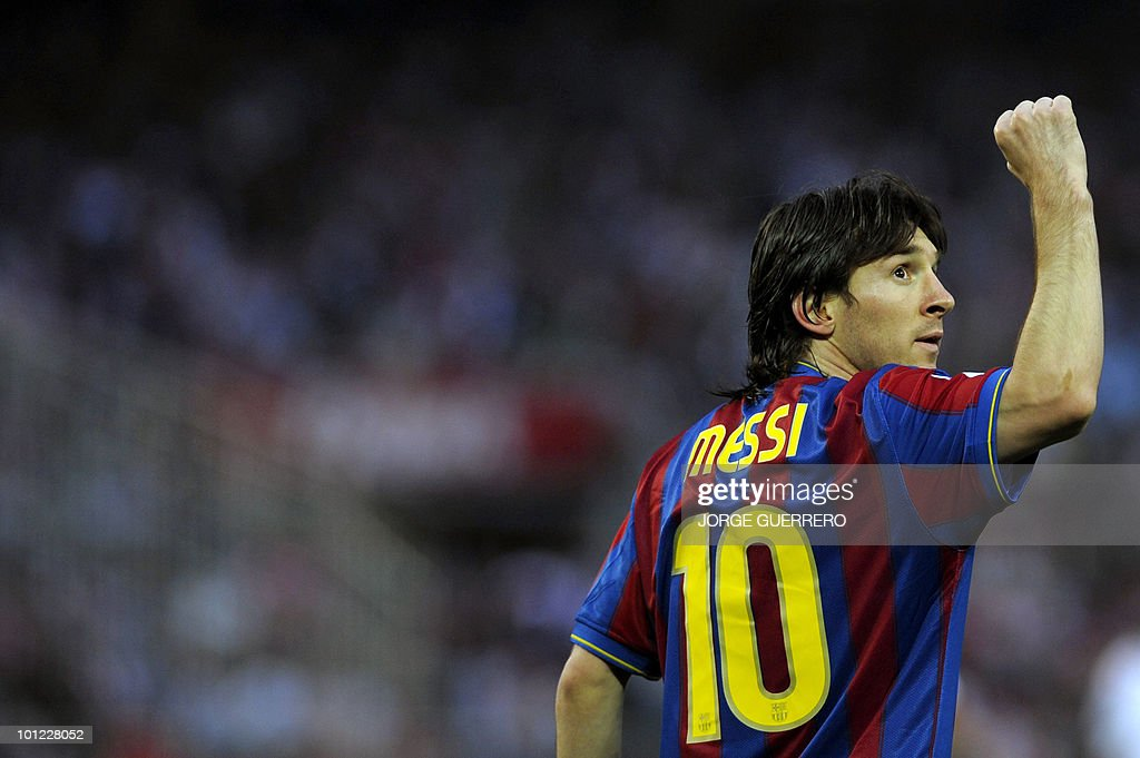 Barcelona's Argentinian forward Lionel Messi celebrates after scoring against Sevilla during a Spanish league football match at Ramon Sanchez Pizjuan stadium in Sevilla on May 8, 2010.