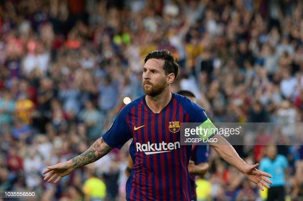 Barcelona's Argentinian forward Lionel Messi celebrates after scoring during the UEFA Champions' League group B football match FC Barcelona against...