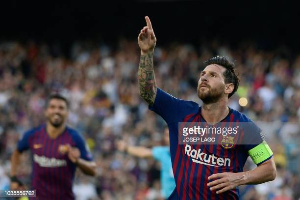 TOPSHOT Barcelona's Argentinian forward Lionel Messi celebrates after scoring during the UEFA Champions' League group B football match FC Barcelona...