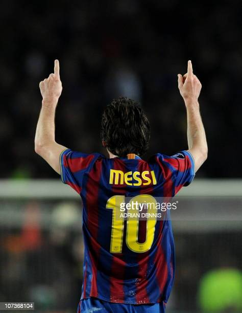 Barcelona's Argentinian forward Lionel Messi celebrates after scoring his hattrick against Arsenal during the Champions League quarterfinal secondleg...