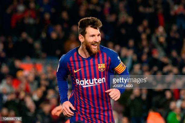 TOPSHOT Barcelona's Argentinian forward Lionel Messi celebrates after scoring during the Spanish League football match between Barcelona and Leganes...
