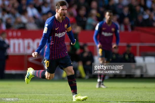 Barcelona's Argentinian forward Lionel Messi celebrates after scoring a goal during the Spanish league football match between Sevilla FC and FC...