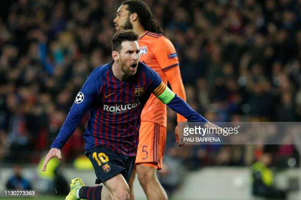 Barcelona's Argentinian forward Lionel Messi celebrates after scoring during the UEFA Champions League round of 16 second leg football match between...
