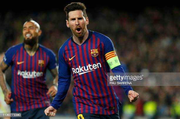 TOPSHOT Barcelona's Argentinian forward Lionel Messi celebrates after scoring during the UEFA Champions League round of 16 second leg football match...