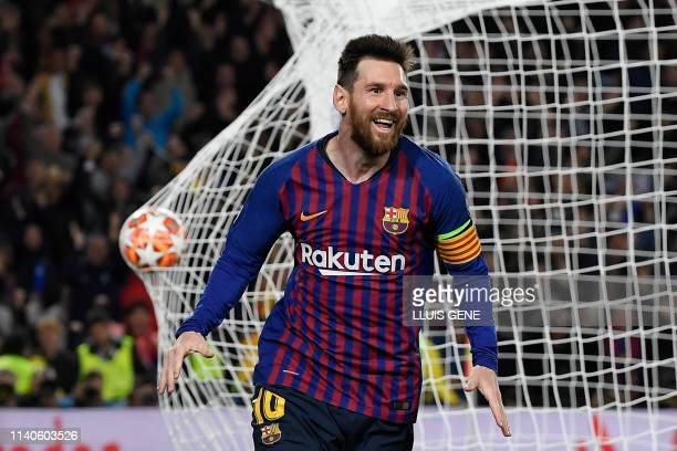 TOPSHOT Barcelona's Argentinian forward Lionel Messi celebrates after scoring a goal during the UEFA Champions League semifinal first leg football...