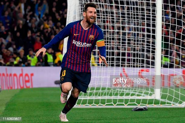 Barcelona's Argentinian forward Lionel Messi celebrates after scoring a goal during the UEFA Champions League semifinal first leg football match...