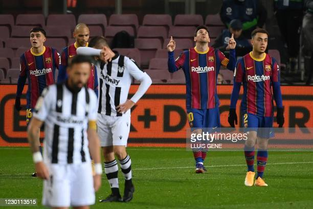 Barcelona's Argentinian forward Lionel Messi celebrates after scoring during the Spanish league football match between FC Barcelona and Levante UD at...