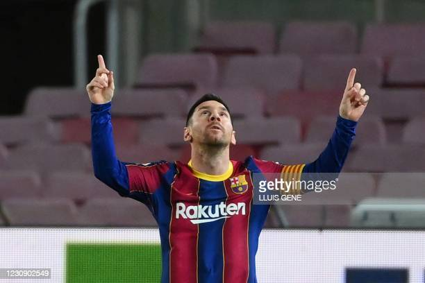 Barcelona's Argentinian forward Lionel Messi celebrates after scoring a goal during the Spanish league football match FC Barcelona against Athletic...