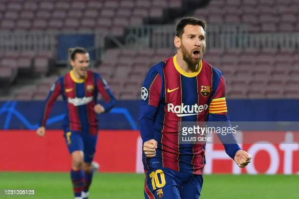 Barcelona's Argentinian forward Lionel Messi celebrates after scoring a goal during the UEFA Champions League round of 16 first leg football match...