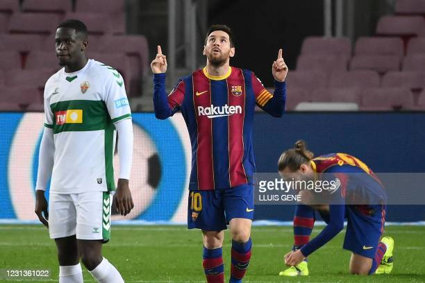 Barcelona's Argentinian forward Lionel Messi celebrates after scoring a goal during the Spanish league football match between FC Barcelona and Elche...