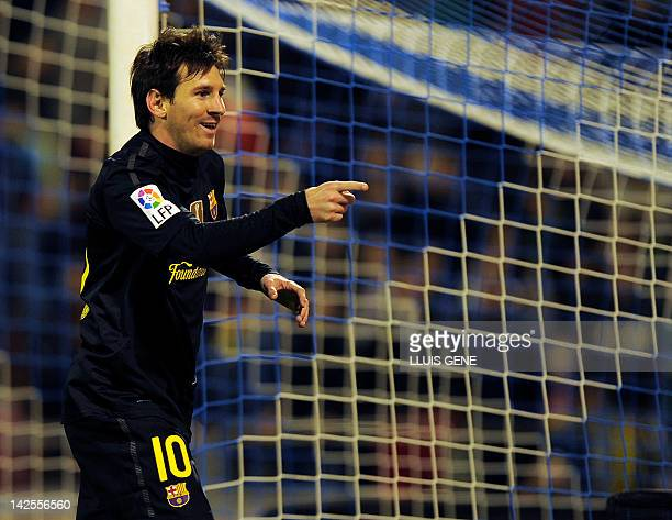 Barcelona's Argentinian forward Lionel Messi celebrates after scoring a goal during the Spanish League football match between Real Zaragoza and FC...