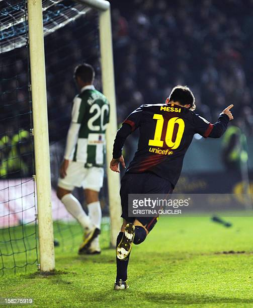 Barcelona's Argentinian forward Lionel Messi celebrates after scoring his second goal during the Spanish Copa del Rey football match Cordoba FC vs FC...