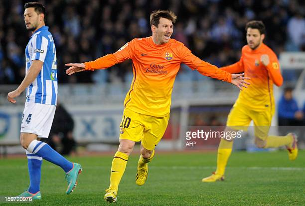 Barcelona's Argentinian forward Lionel Messi celebrates after scoring his team's first goal during the Spanish league football match Real Sociedad vs...