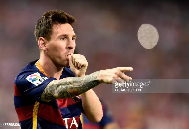 Barcelona's Argentinian forward Lionel Messi celebrates after scoring during the Spanish league football match Club Atletico de Madrid vs FC...