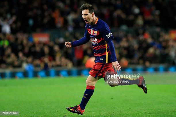 Barcelona's Argentinian forward Lionel Messi celebrates after scoring during the Spanish Copa del Rey round of 16 first leg football match FC...