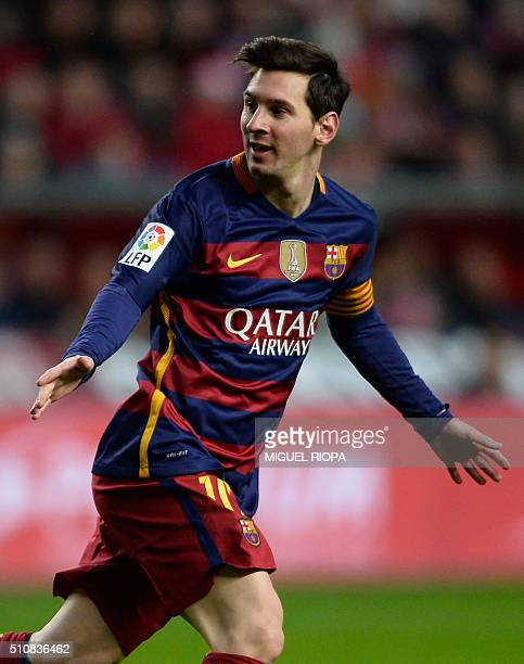 Barcelona's Argentinian forward Lionel Messi celebrates after scoring a goal during the Spanish league football match Real Sporting de Gijon vs FC...