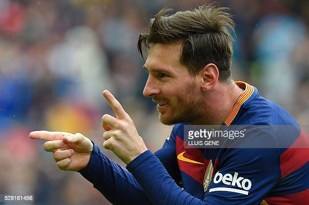 Barcelona's Argentinian forward Lionel Messi celebrates after scoring a goal during the Spanish league football match FC Barcelona vs RCD Espanyol at...