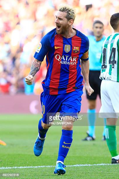 Barcelona's Argentinian forward Lionel Messi celebrates after scoring during the Spanish league football match FC Barcelona vs Real Betis Balompie at...