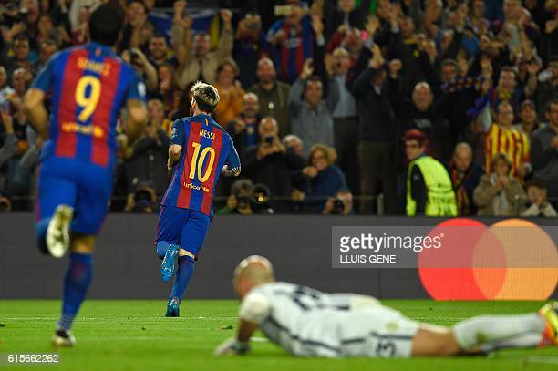 Barcelona's Argentinian forward Lionel Messi celebrates after scoring a goal during the UEFA Champions League football match FC Barcelona vs...