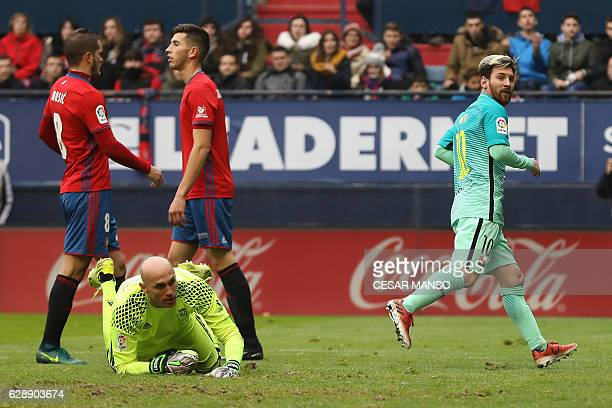 Barcelona's Argentinian forward Lionel Messi celebrates after scoring during the Spanish league football match CA Osasuna vs FC Barcelona at the...