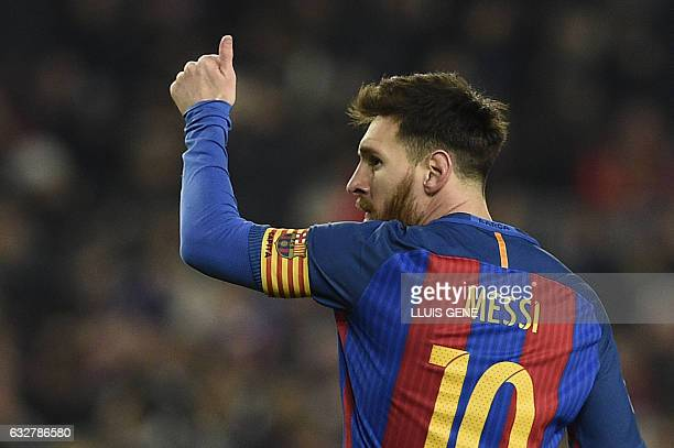 TOPSHOT Barcelona's Argentinian forward Lionel Messi celebrates after scoring during the Spanish Copa del Rey quarter final second leg football match...