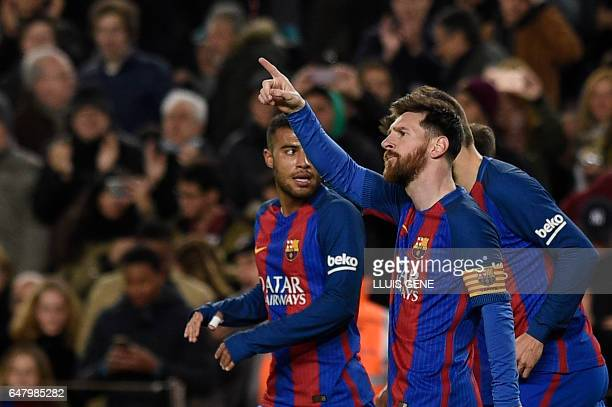 TOPSHOT Barcelona's Argentinian forward Lionel Messi celebrates after scoring a goal during the Spanish league football match FC Barcelona vs RC...