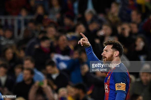 Barcelona's Argentinian forward Lionel Messi celebrates after scoring a goal during the Spanish league football match FC Barcelona vs RC Celta de...