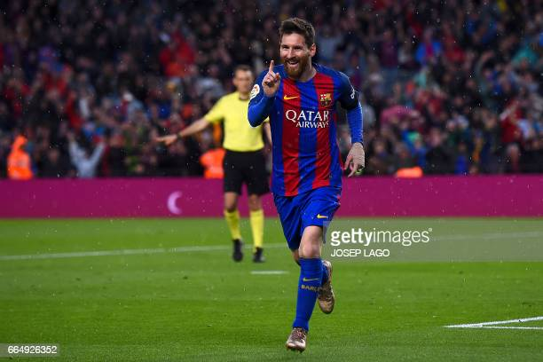 Barcelona's Argentinian forward Lionel Messi celebrates after scoring a goal during the Spanish league football match FC Barcelona vs Sevilla CF at...