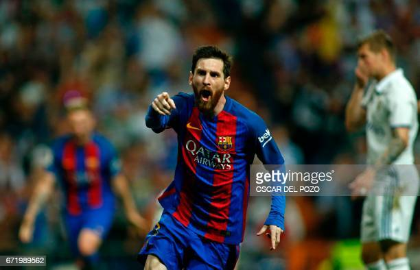 Barcelona's Argentinian forward Lionel Messi celebrates after scoring during the Spanish league Clasico football match Real Madrid CF vs FC Barcelona...