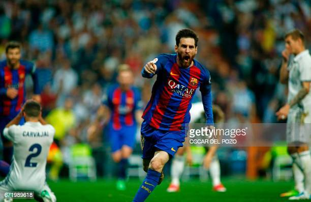 TOPSHOT Barcelona's Argentinian forward Lionel Messi celebrates after scoring during the Spanish league Clasico football match Real Madrid CF vs FC...