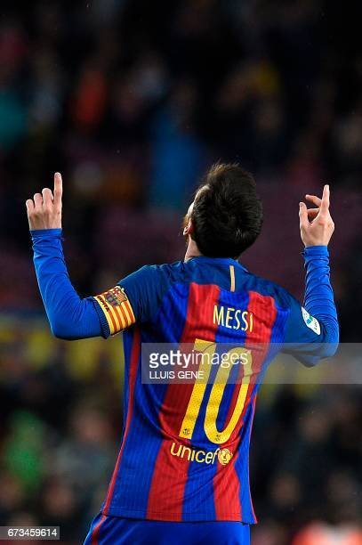 Barcelona's Argentinian forward Lionel Messi celebrates after scoring a goal during the Spanish league football match FC Barcelona vs CA Osasuna at...