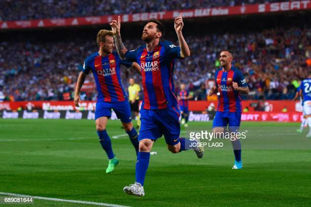 TOPSHOT Barcelona's Argentinian forward Lionel Messi celebrates after scoring the opener during the Spanish Copa del Rey final football match FC...