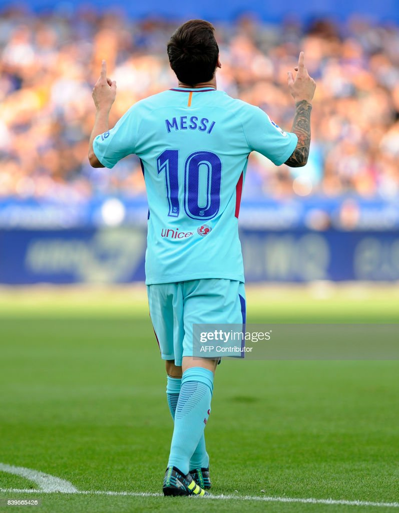 Barcelona's Argentinian forward Lionel Messi celebrates after scoring during the Spanish league football match Deportivo Alaves vs FC Barcelona at the Mendizorroza stadium in Vitoria on August 26, 2017. /