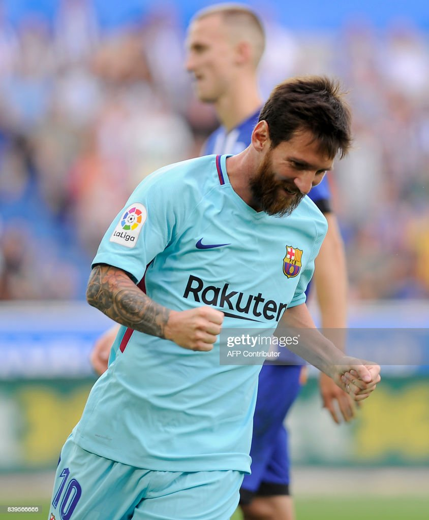 Barcelona's Argentinian forward Lionel Messi celebrates after scoring his team's second goal during the Spanish league football match Deportivo Alaves vs FC Barcelona at the Mendizorroza stadium in Vitoria on August 26, 2017. /