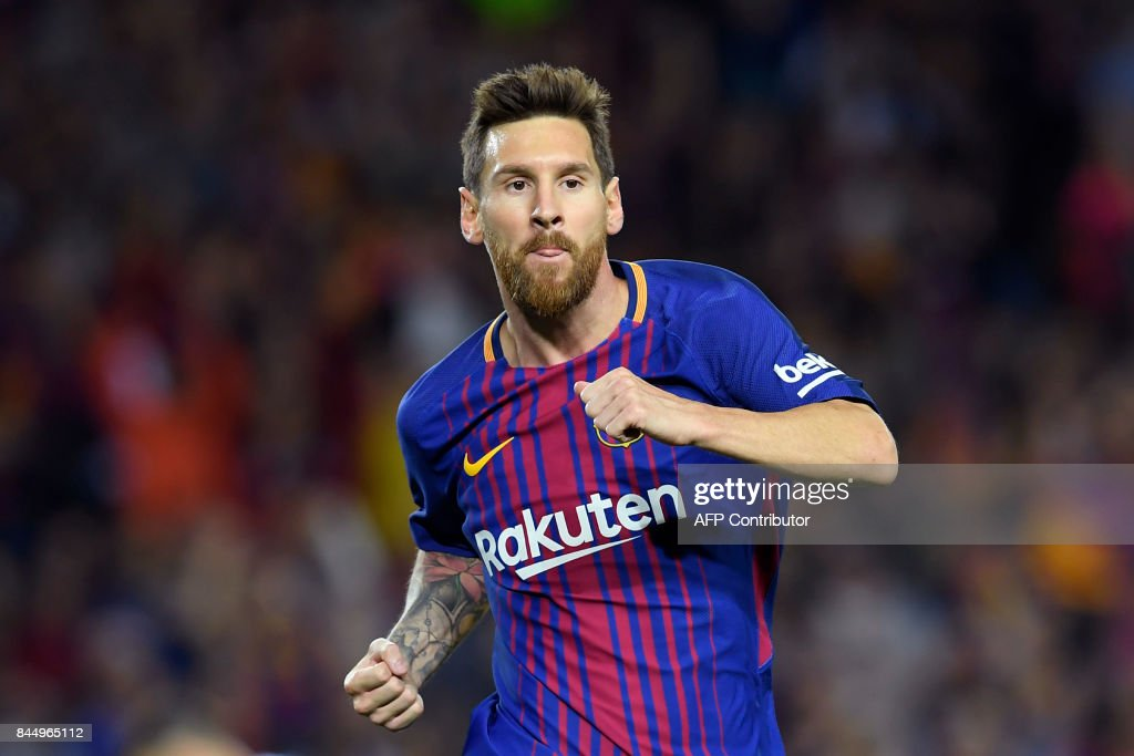 Barcelona's Argentinian forward Lionel Messi celebrates after scoring during the Spanish Liga football match Barcelona vs Espanyol at the Camp Nou stadium in Barcelona on September 9, 2017. /