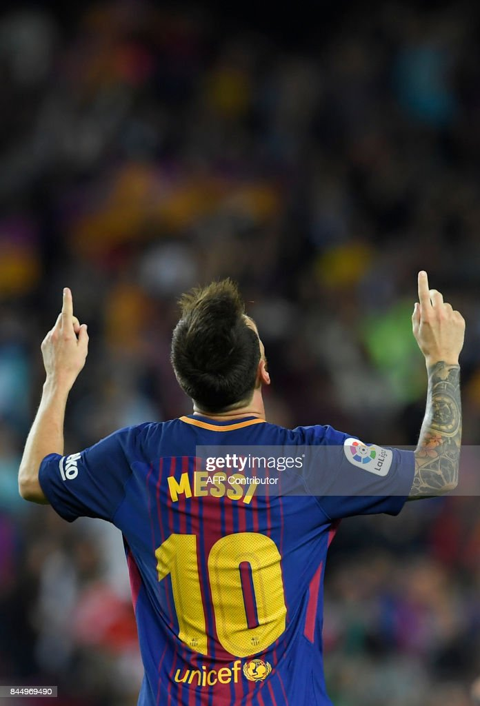Barcelona's Argentinian forward Lionel Messi celebrates after scoring his second goal during the Spanish Liga football match Barcelona vs Espanyol at the Camp Nou stadium in Barcelona on September 9, 2017. /