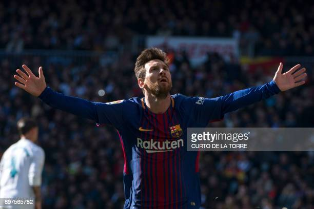 TOPSHOT Barcelona's Argentinian forward Lionel Messi celebrates after scoring during the Spanish League 'Clasico' football match Real Madrid CF vs FC...
