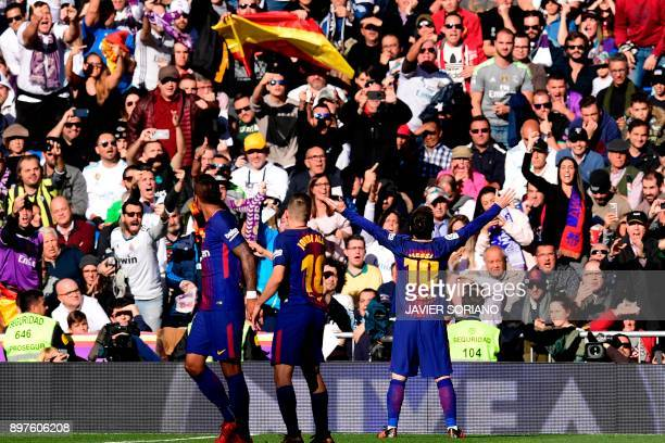 Barcelona's Argentinian forward Lionel Messi celebrates after scoring during the Spanish League 'Clasico' football match Real Madrid CF vs FC...