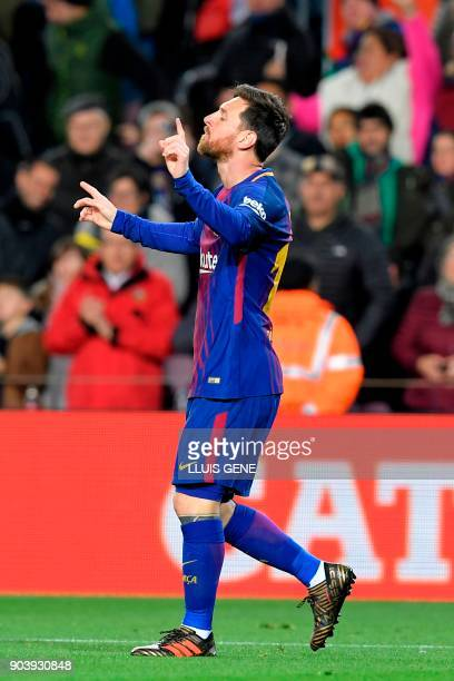 Barcelona's Argentinian forward Lionel Messi celebrates after scoring during the Spanish Copa del Rey round of 16 second leg football match FC...