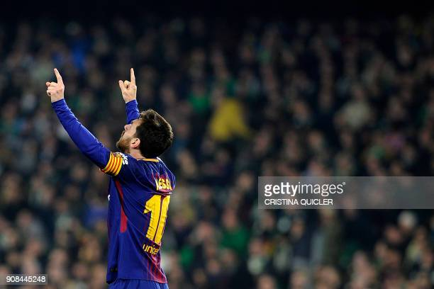 Barcelona's Argentinian forward Lionel Messi celebrates after scoring a goal during the Spanish league football match between Real Betis and FC...
