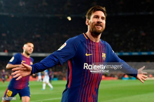 Barcelona's Argentinian forward Lionel Messi celebrates after scoring a goal during the Spanish 'Copa del Rey' quarterfinal second leg football match...