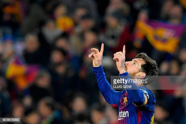 Barcelona's Argentinian forward Lionel Messi celebrates after scoring during the Spanish league football match between FC Barcelona and Girona FC at...