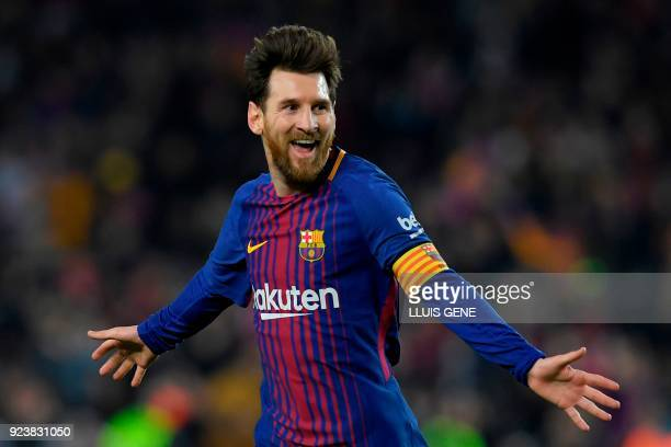 TOPSHOT Barcelona's Argentinian forward Lionel Messi celebrates after scoring his second goal during the Spanish league football match between FC...