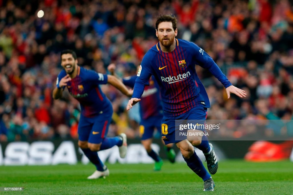Barcelona's Argentinian forward Lionel Messi celebrates after scoring during the Spanish league football match FC Barcelona against Club Atletico de Madrid at the Camp Nou stadium in Barcelona on March 04, 2018. / AFP PHOTO / Pau Barrena