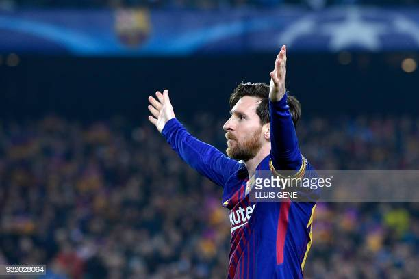 Barcelona's Argentinian forward Lionel Messi celebrates after scoring a goal during the UEFA Champions League round of sixteen second leg football...