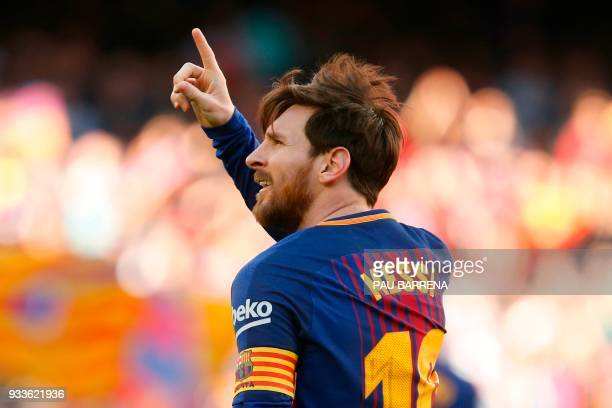 TOPSHOT Barcelona's Argentinian forward Lionel Messi celebrates after scoring during the Spanish League football match between FC Barcelona and...