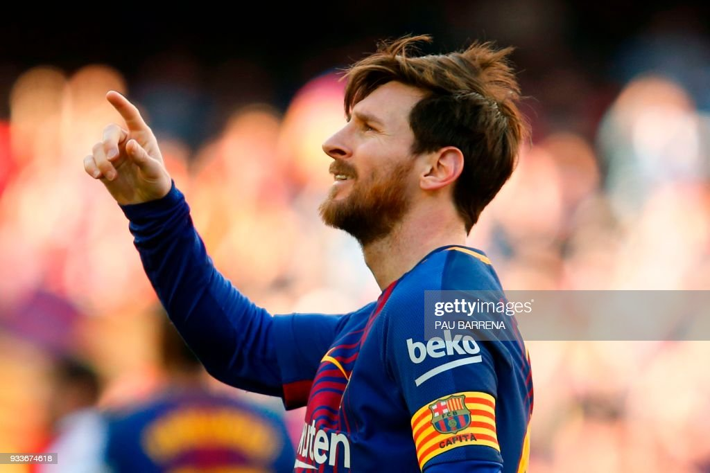 TOPSHOT - Barcelona's Argentinian forward Lionel Messi celebrates after scoring during the Spanish League football match between FC Barcelona and Athletic Club Bilbao at the Camp Nou stadium in Barcelona on March 18, 2018. / AFP PHOTO / Pau Barrena